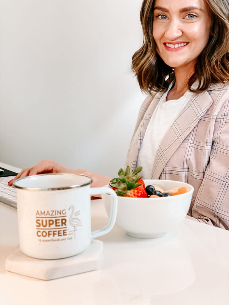 Woman working while drinking Super Amazing Coffee